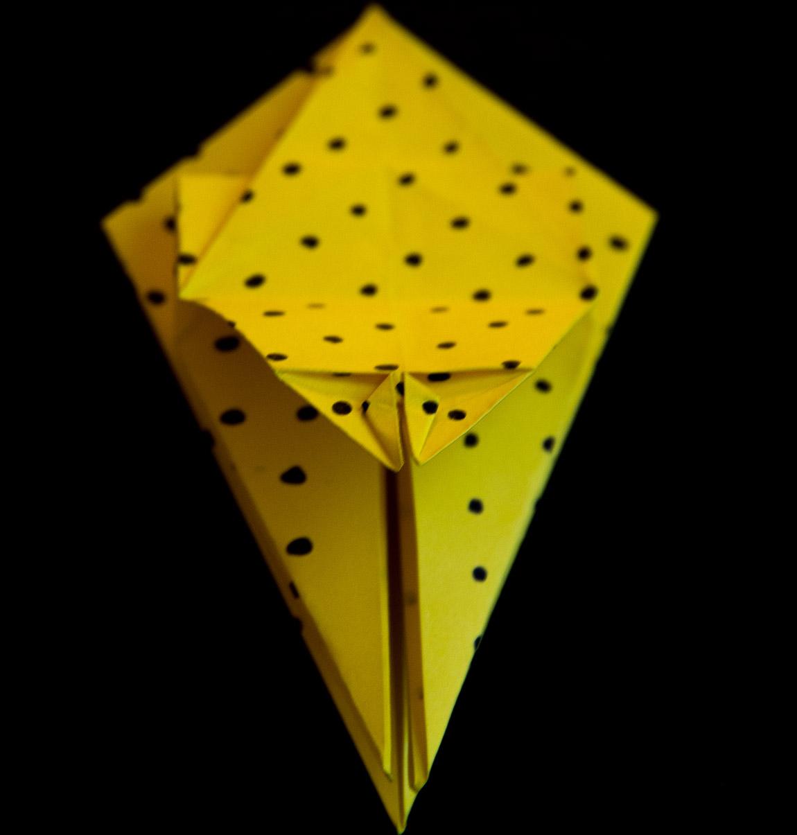 Zoom : Enfonce le triangle à l'intérieur